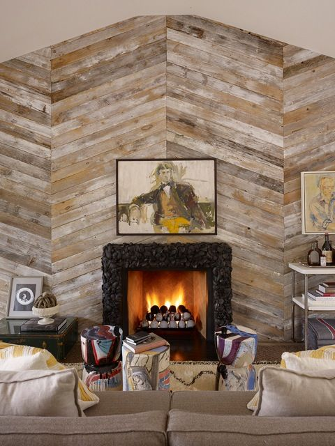 Love the herringbone reclaimed wood wall with the dyed oyster shell fireplace surround.