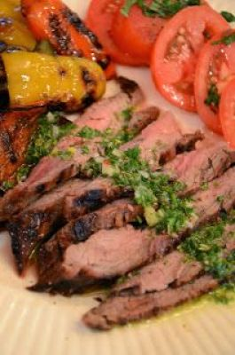 StoneGable: grilled balsamic flank steak with chimichurri sauce.. served over greens