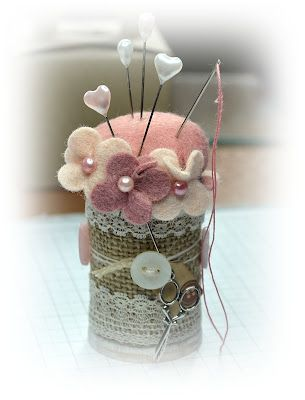 wooden spool pin cushion...  I'm going to make this with medicine bottles.  You could then put extra pins and needles or buttons inside.  Cute!