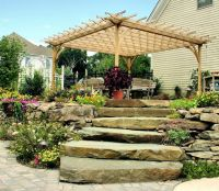 raised patio, rock retaining wall | For the Cabin | Pinterest