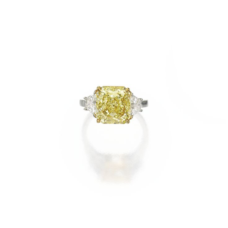 Platinum, 18 karat gold, fancy intense yellow diamond and diamond ring