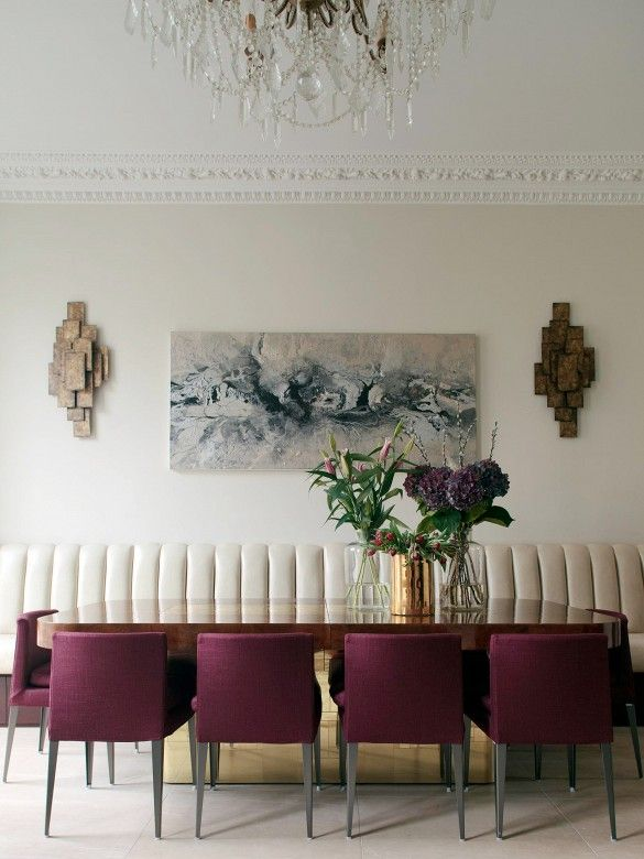 Cream dining room with Brutalists sconces and burgundy chairs