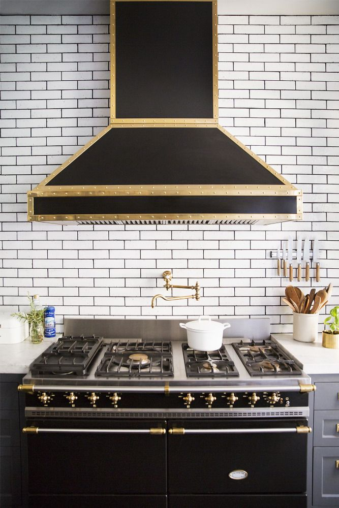 Metallic kitchen rangehood on domino.com