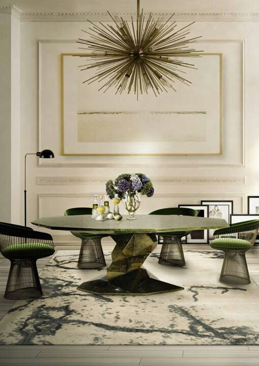 midcentury modern aesthetic—Platner chairs, a sputnik chandelier, an abstract table, and painterly rug