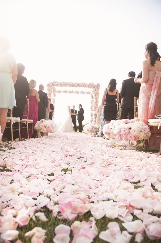 No flower girl? Decorate your aisle with pretty pink petals.
