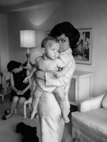 Eartha Kitt having fun with daughter Kitt. looking like fiyah!!! get it Eartha!!
