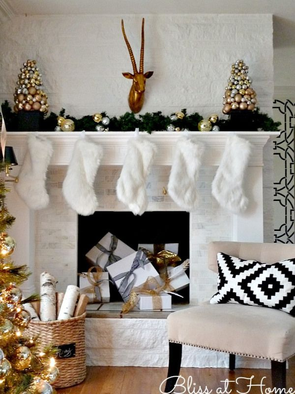 holiday-mantel-2013 bliss at home amazing mantle in white and gold- love the birch, brass antelope, white fuzzy stockings