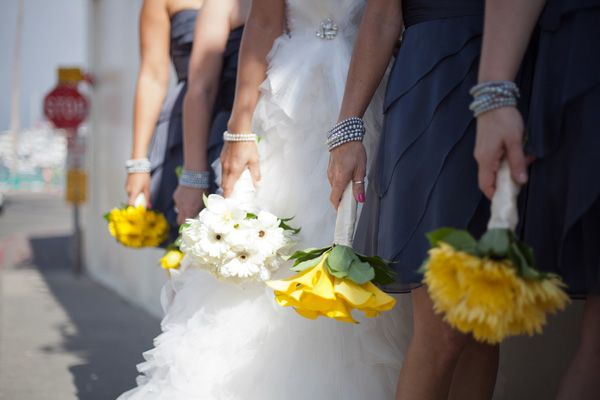 charcoal bridesmaids with yellow bouquets