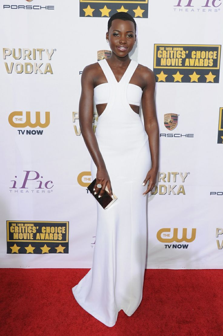 Lupita Nyong'o wears white cut-out Calvin Klein Collection dress and clutch, and Kimberly McDonald Jewels. #CriticsChoiceAwards
