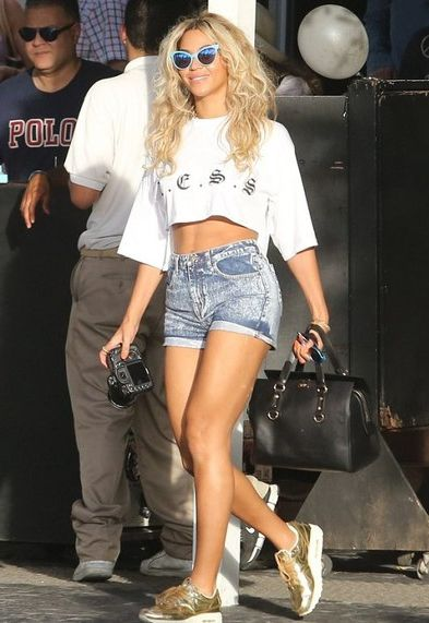 Beyonce Knowles wearing Wildfox La Femme Deluxe Sunglasses Less Clothing Midi Crop Top Nike Air Max 1 SP sneakers in Gold