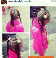 little girl with long cornrow ponytails