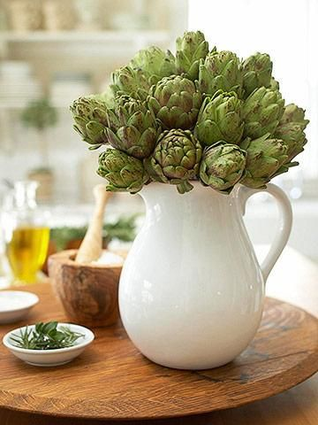 Artichoke Flowers in white ceramic pitcher.