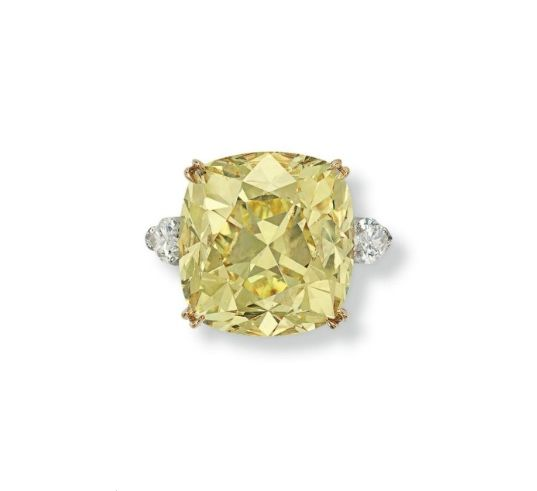 An important 36.09 carats cushion-cut fancy intense yellow diamond and diamond ring