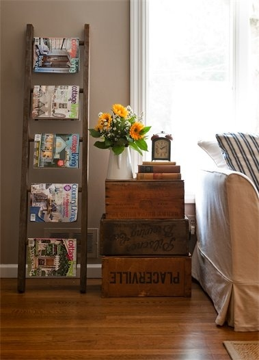 vintage ladder as magazine rack perhaps this is what I should do with the loft ladders - lol!