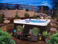 Landscaping around hot tub | Backyard Reno | Pinterest