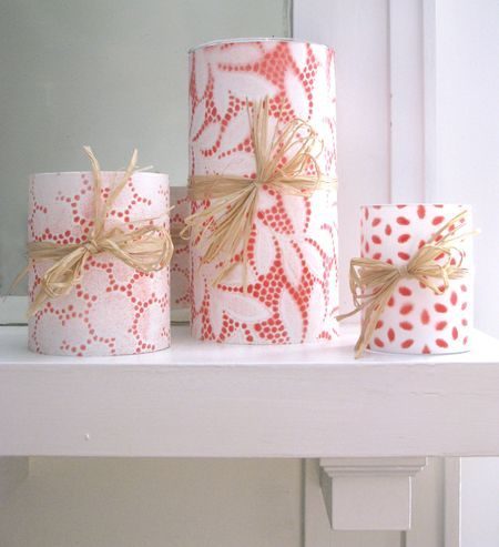 Cover candle with lace. Spray paint. Let paint dry and peel off lace. So pretty!