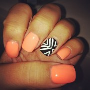 coral nails with black and white
