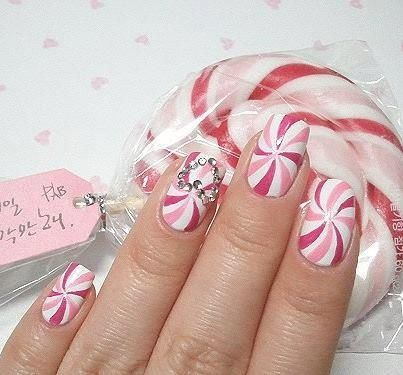 Peppermint candy swirl nail design