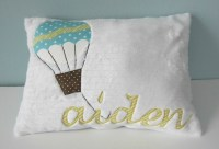 A Personalized Hot Air Balloon with Colorful Clouds Pillow