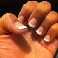 Short natural gel polished nails.