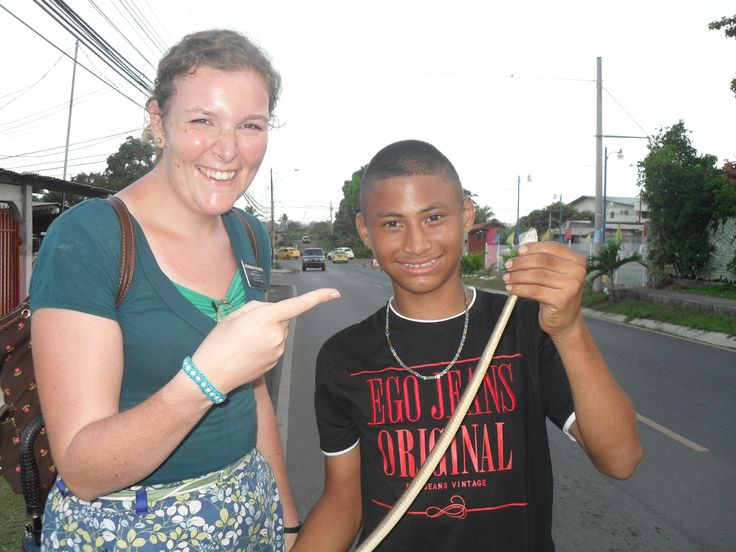 a kid with a dead snake , we met him in the road.