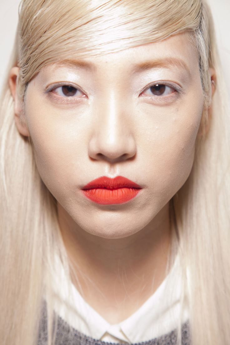 Fall Brights: Designer Ohne Titel sent his models down the runway almost completely barefaced, save for a punch of tangerine across the lips.