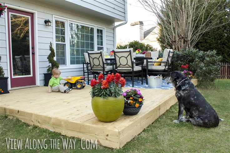 Outdoor patio redesign: new deck on top of concrete slab