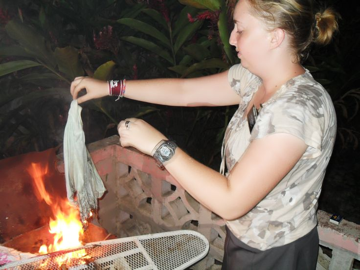 Vroom burning a shirt for her one year. We decided since we were cooking the cashews we should burn the shirt too.