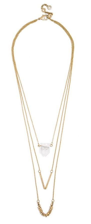 Get an expertly layered look with this delicate three-tiered necklace, embellished with textured gold and raw crystal.