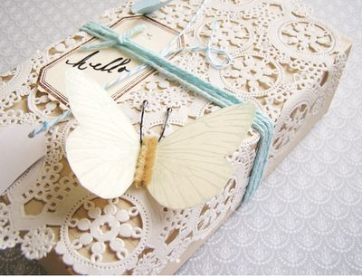 Pretty paper lace wrapping, butterfly & blue string, Love it!