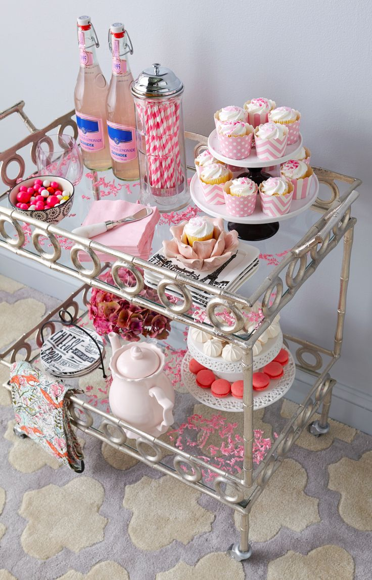 Bar cart makeover DIY: Surprise your guests with a #HomeGoodsHappy dessert cart! Cake stands, colorful straws and napkins make for a fun and festive update. For more entertaining inspiration, click through to our Design Happy blog.