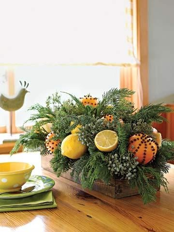 Easy Fruit Box Use a wooden box to serve as a centerpiece. Fill the base with dry floral foam, then tuck mixed evergreens throughout. Attach citrus fruits, such as oranges, lemons and limes, to floral picks, and tuck them into the greenery. For the clove patterns, use a pencil to draw spirals or other designs on an orange, then poke whole cloves into the skin at evenly spaced points.