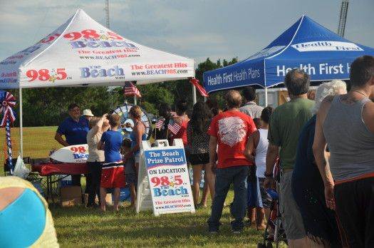 Check out the line to spin at this tent at Palm Bay's Splashes & Sparks.