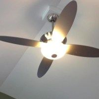 Modern ceiling fan on cathedral ceiling.
