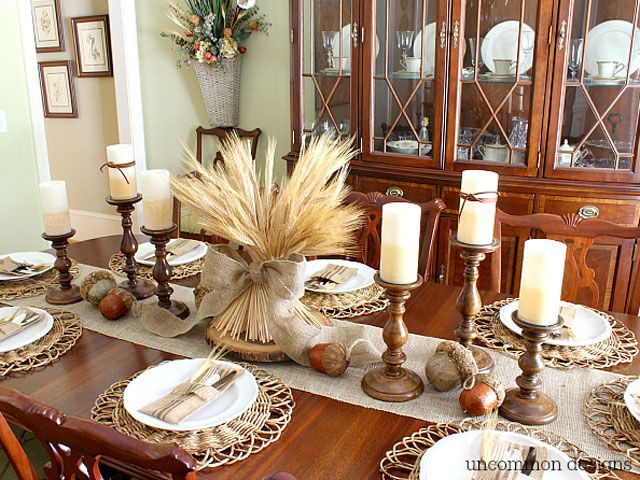 Pair a bundle of wheat with brown candlesticks to create a neutral yet earthy tablescape.