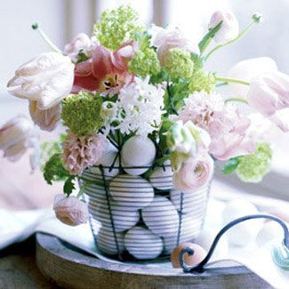 Streamline your decorating by combining undyed eggs and a casual bouquet in a single, simple arrangement. #Easter