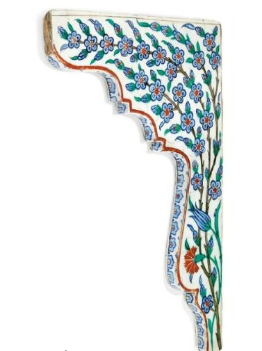 An Iznik pottery tile spandrel, Ottoman Turkey, circa 1575