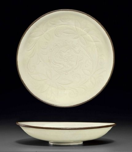 A rare dingyao carved dish, Northern Song dynasty, 11th-12th century