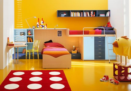 Triadic Children's Bedroom  This room contains the primary colours (red, yellow and blue), making this room triadic.