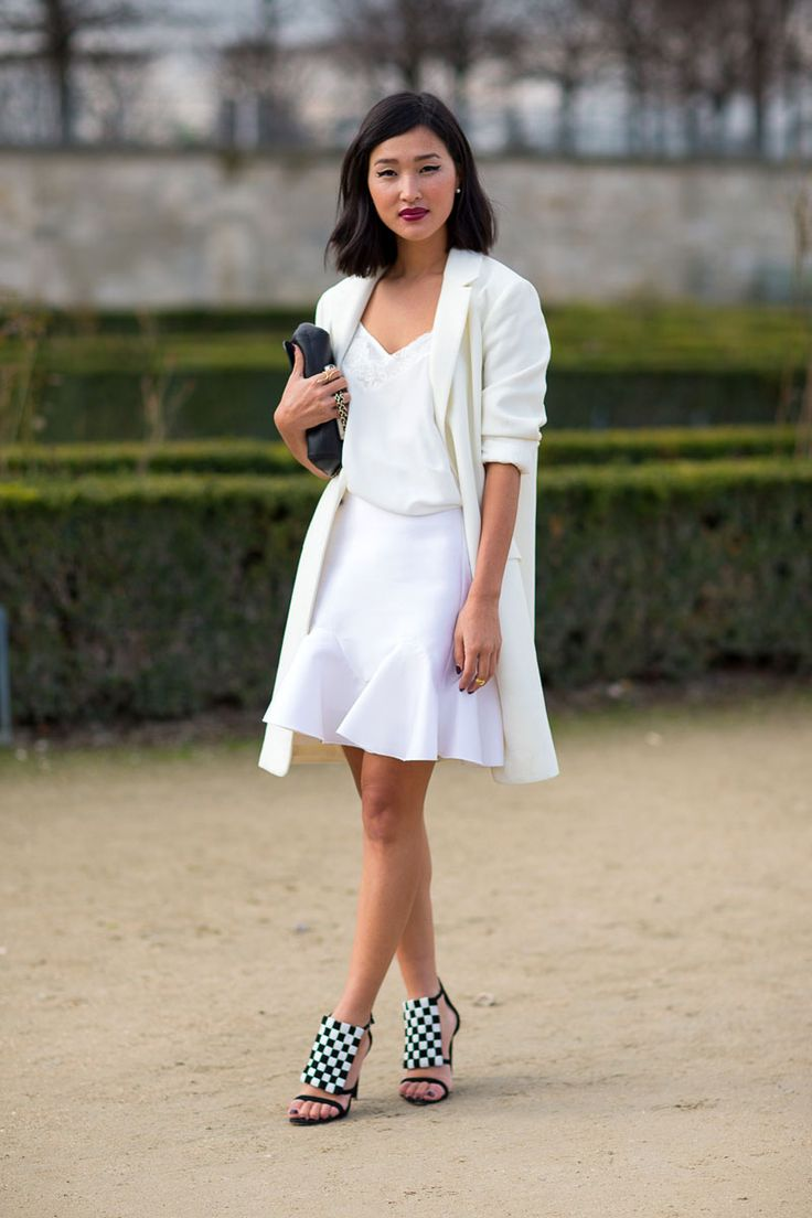 Street style in Paris: all white outfit- dress &  jacket with checkered sandals.
