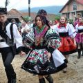 Locals wearing traditional romanian clothes at a wedding in maramures