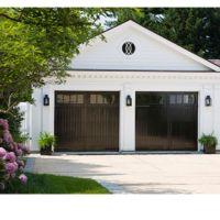 Shiny black garage doors | Inviting Exteriors | Pinterest