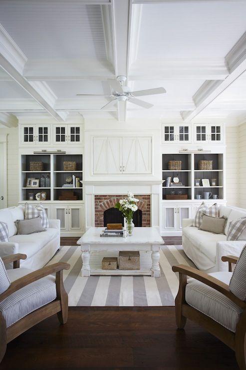 living rooms - hardwood floors, brick fireplace surround, white slipcovered sofa