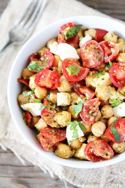 Chickpea, Pesto, Tomato, and Mozzarella Salad Recipe on twopeasandtheirpod.com Only 4 ingredients needed to make this healthy salad! #salad