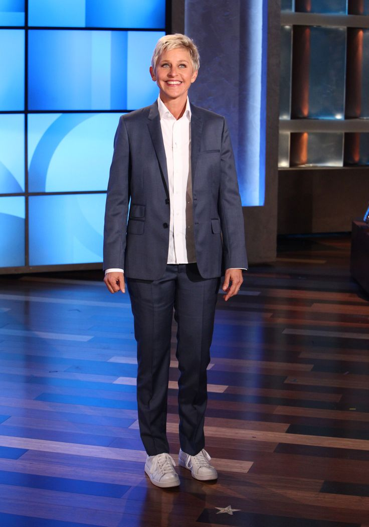 Ellen's Look of the Day: Blue suit, crisp white shirt, Stan Smith Adidas shoes, Falke socks.