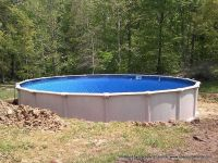 24ft St Thomas Above Ground Swimming Pool buried halfway ...