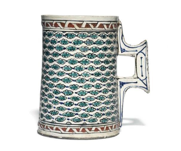A large Iznik pottery tankard, Ottoman Turkey, circa 1580