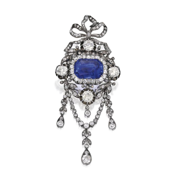 GOLD, SILVER, SAPPHIRE AND DIAMOND BROOCH