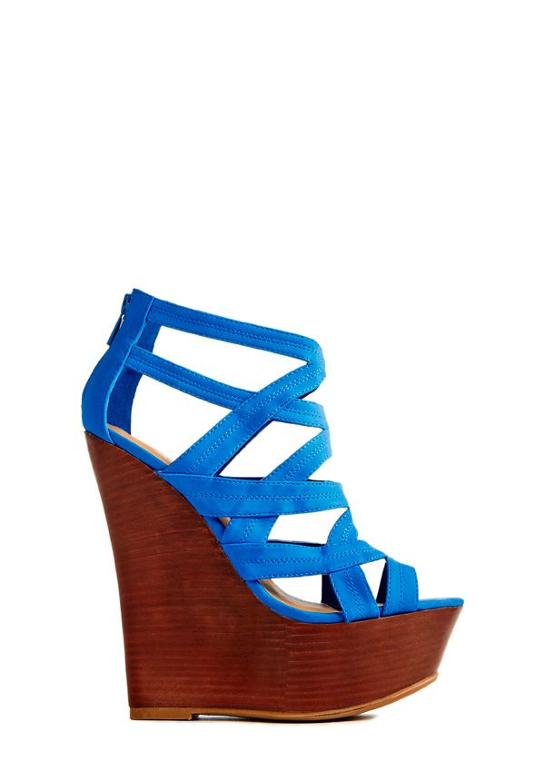 Get high and mighty with Miami by JustFab! Sculpted faux wood wedge featuring lush straps with caged design and back zip to secure your step.