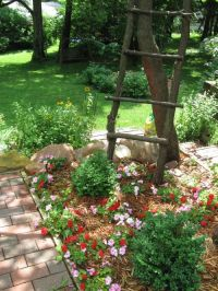 cute flower bed with rustic ladder | Home | Pinterest